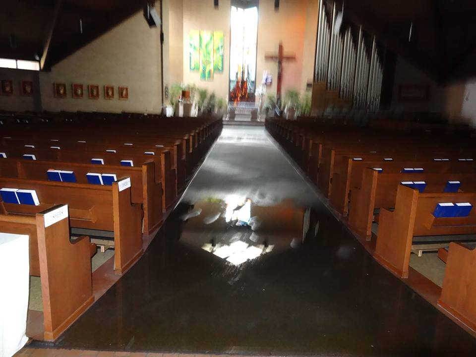 Flooded sanctuary of Saint Alphonsus Church in Greenwell Springs, LA